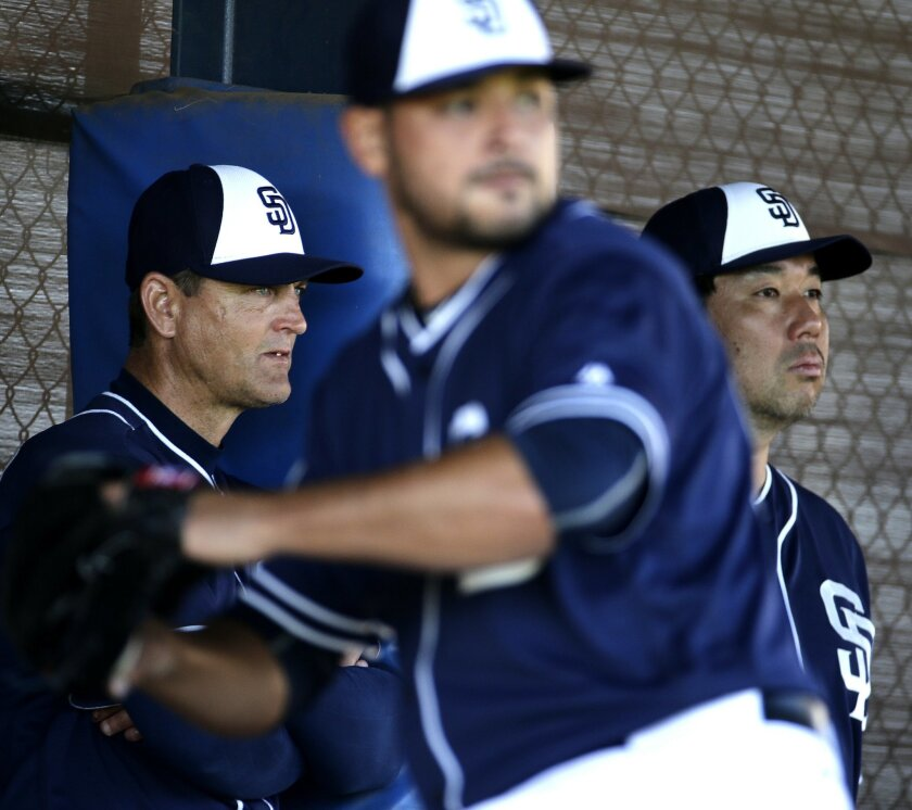 San Diego Padres baseball operations advisors Trevor Hoffman, left, and Hideo Nomo, right, watch pitchers throw during spring training baseball practice Monday, Feb. 22, 2016, in Peoria, Ariz. (AP Photo/Charlie Riedel)