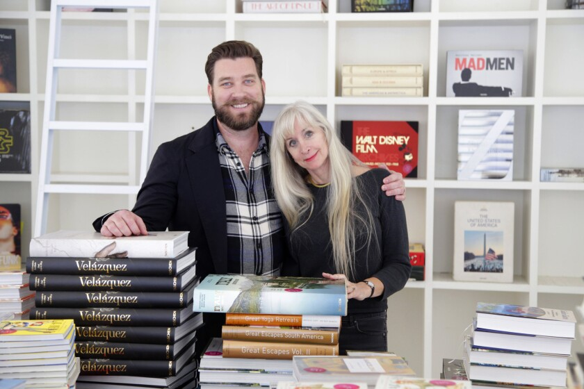 The Los Angeles headquarters of Taschen publishing is moving from its historic office at Hollywood's Crossroads of the World building. Pictured are editors Creed Poulson, left, and Dian Hanson.