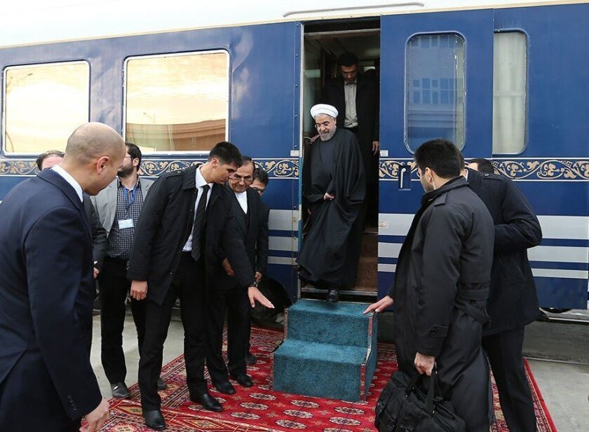 Iranian President Hassan Rouhani arrives in Ak-Yayla, Turkmenistan, on Wednesday for the ceremonial opening of a new freight link across Central Asia.