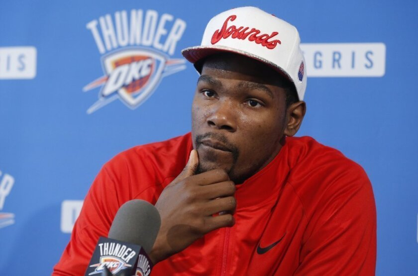 Oklahoma City Thunder forward Kevin Durant listens to a question during a news conference.