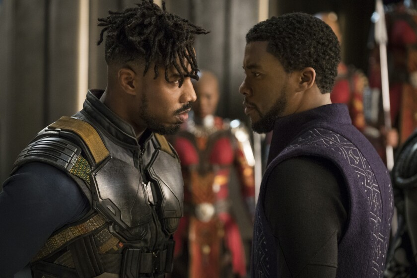 "Los personajes de Erik Killmonger (Michael B. Jordan) y T'Challa (Chadwick Boseman) en una escena de ""Black Panther"", que promete conquistar la taquilla de este fin de semana."