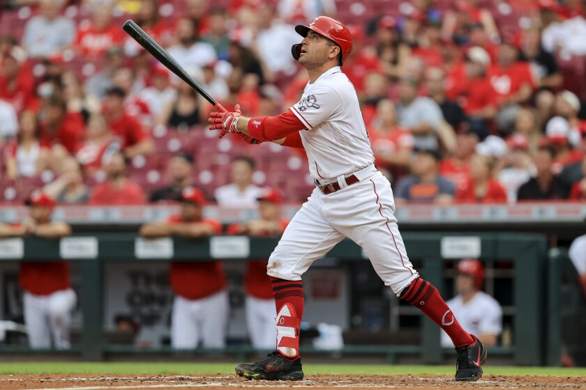 Cincinnati Reds' Joey Votto watches his three-run home run during the third inning of the team's baseball game against the Colorado Rockies in Cincinnati, Friday, June 11, 2021. (AP Photo/Aaron Doster)