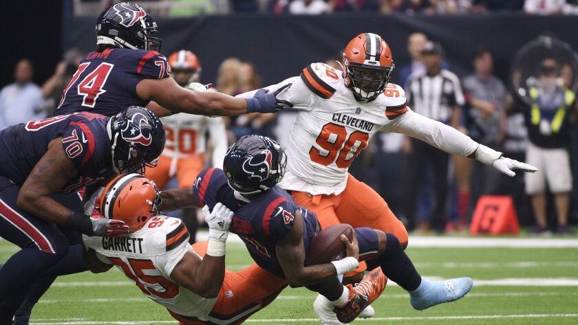 Houston Texans quarterback Deshaun Watson (4) is sacked by Cleveland Browns defensive end Myles Garr
