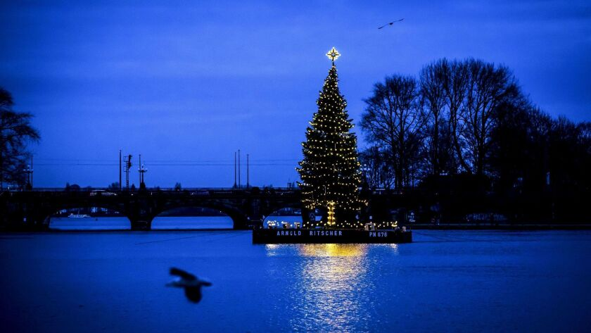 An illuminated Christmas tree floats on the Binnenalster Lake surface in Hamburg, Germany on Dec. 4.