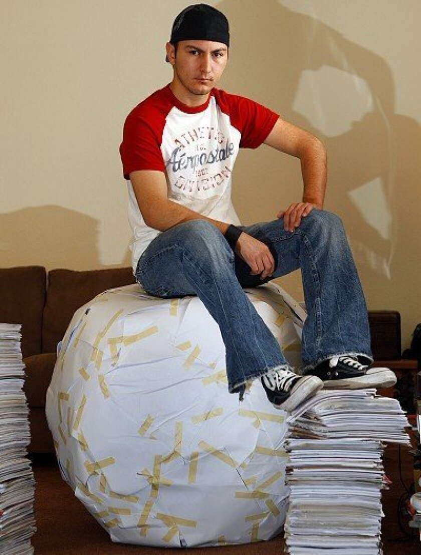 Enrique Miramontes got the idea to create a giant ball made of paper when he was in high school. The ball is now three feet tall and weighs 200 pounds.
