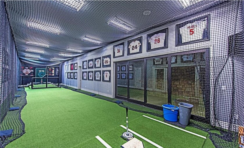 The home features a movie theater, wine cellar, game room and indoor batting cage