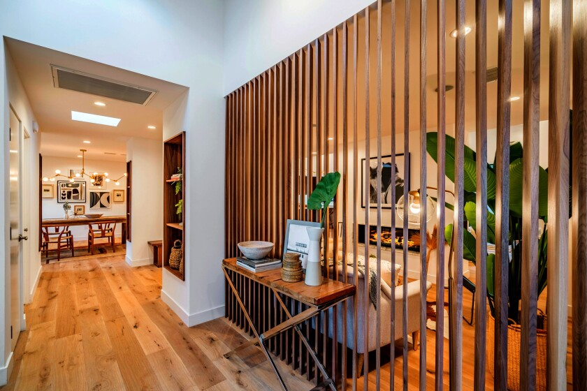 Our Home of the Week features wide-plank hardwood floors, an angled wooden partition wall and a living room fireplace.
