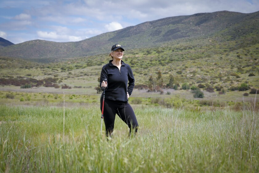 Jamie Gold sets off on one of her weekly hikes in the hills east of Chula Vista.