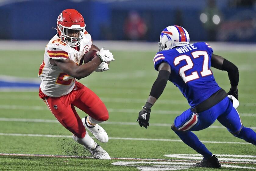 Kansas City Chiefs running back Clyde Edwards-Helaire runs the ball as Buffalo Bills cornerback Tre'Davious White defends.