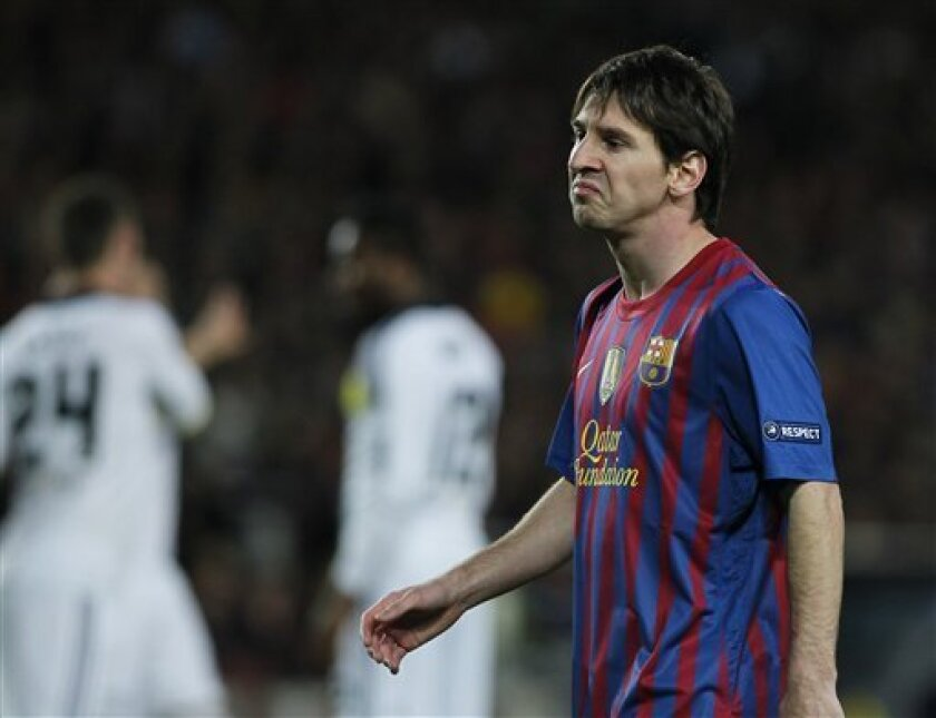 Barcelona's Lionel Messi gestures during a Champions League second leg semifinal soccer match against Chelsea at Camp Nou stadium, in Barcelona, Spain, Tuesday, April 24, 2012. (AP Photo/Andres Kudacki)
