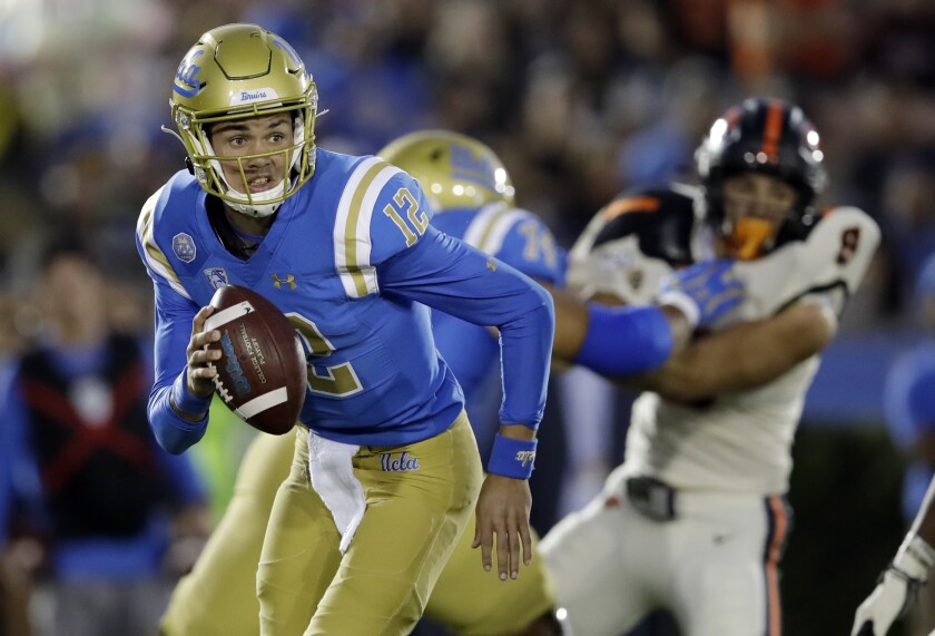 UCLA quarterback Austin Burton runs out of the pocket against Oregon State during the first half of an NCAA college football game Saturday, Oct. 5, 2019, in Pasadena.