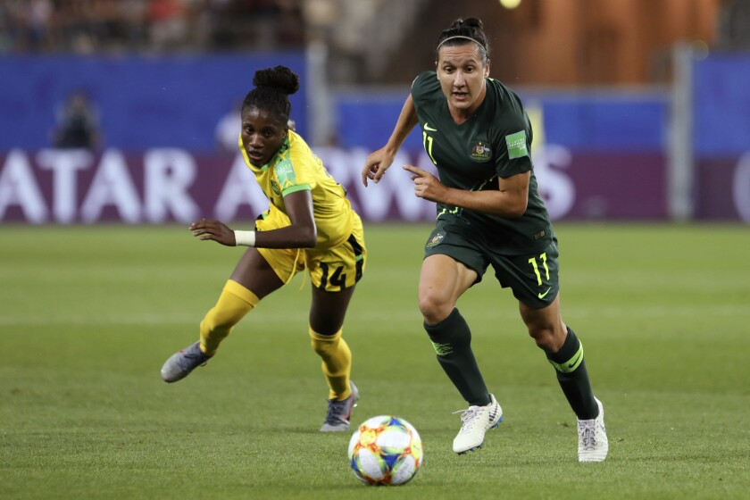 FILE - In this June 18, 2019, file photo, Australia's Lisa De Vanna, right, challenges for the ball with Jamaica's Den-Den Blackwood during the Women's World Cup Group C soccer match in Grenoble, France. De Vanna, who played 150 games for Australia and was second on the list of all-time of scorers for the women's national team with 47 goals, said she first experienced harassment, abuse and bullying in 2001 when she joined a national women's squad at age 17. (AP Photo/Laurent Cipriani, File)