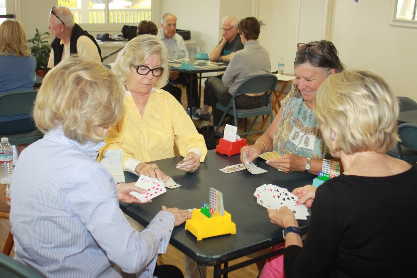 Players at the Soledad Club enjoy a game of Bridge.