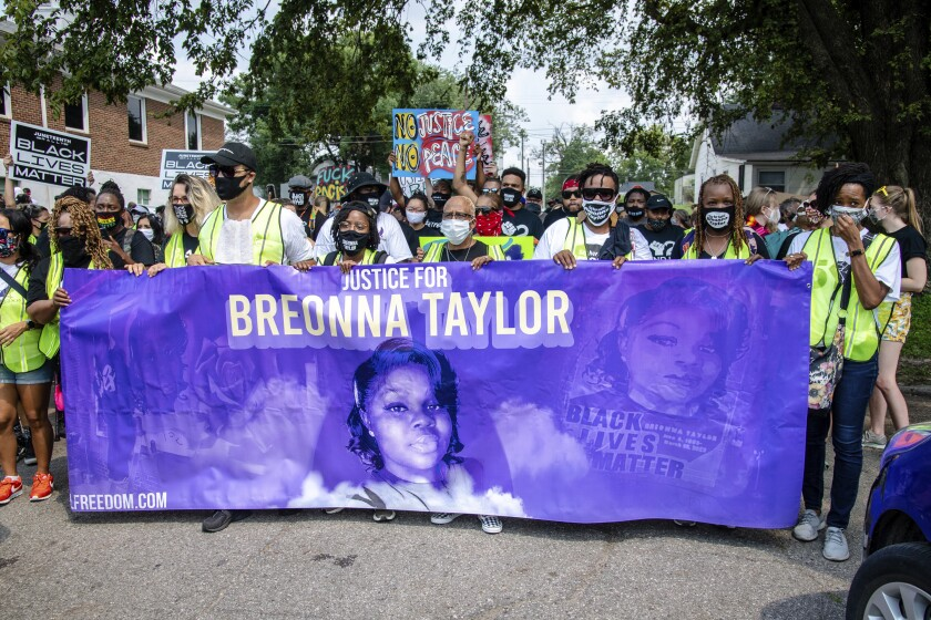 FILE - Protesters participate in the Good Trouble Tuesday march for Breonna Taylor, on Tuesday, Aug. 25, 2020, in Louisville, Ky. A lawyer for Breonna Taylor's family said a plea deal was offered to an accused drug trafficker that would have forced him to implicate Taylor, who was killed by police in a raid on her home in March. Louisville's top prosecutor acknowledged the existence of the document but said it was part of preliminary plea negotiations with a man charged with illegal drug trafficking and not an attempt to smear Taylor.(Amy Harris/Invision/AP File)
