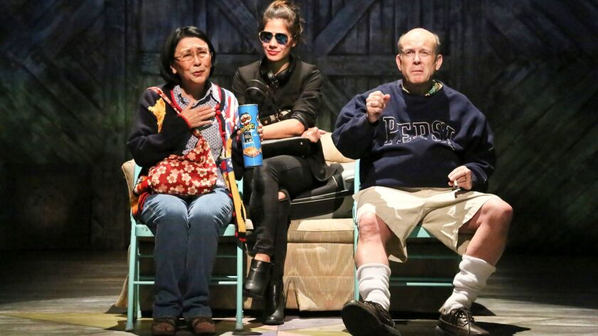 "Hiro (Jessica Jade Andres) is flanked by her emotionally abusive father (James B. Harnagel) and her downtrodden mother (Dian Kobayashi) in East West Players production of ""Kentucky."""