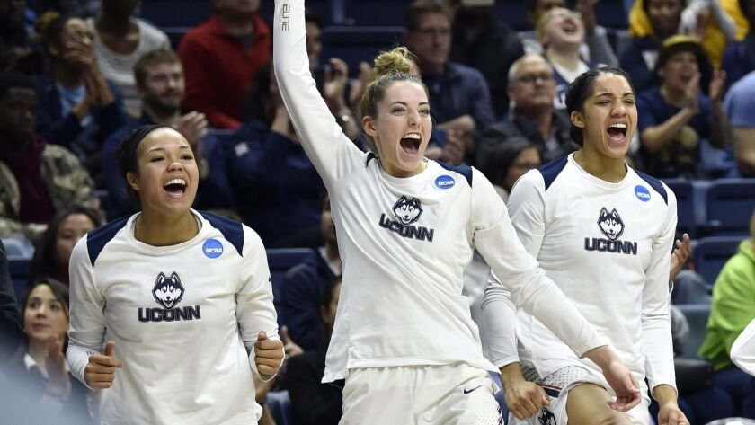 Connecticut Huskies players (left to right) Napheesa Collier (24), Katie Lou Samuelson (33) and Gabby Williams (15) celebrate from the bench during a first round NCAA tournament victory at Gampel Pavilion. UConn won the game 140-52.