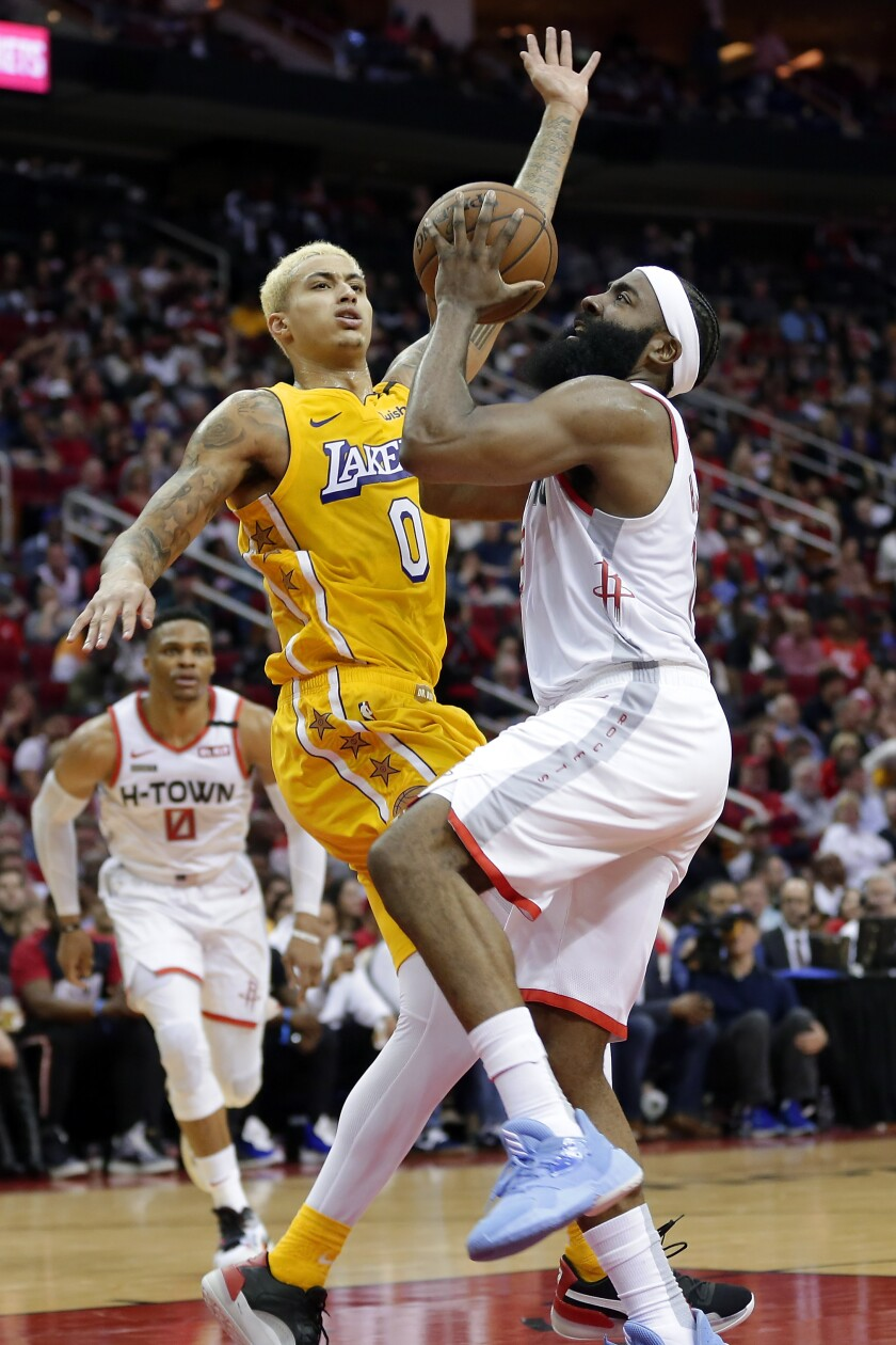 Lakers forward Kyle Kuzma pressures Rockets guard James Harden into a shot during the second half of a game Jan. 18 at Toyota Center.