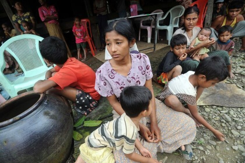Muslim residents take shelter at a house in Thabyu Chai village near Thandwe in western Myanmar on Wednesday amid fresh anti-Muslim unrest.
