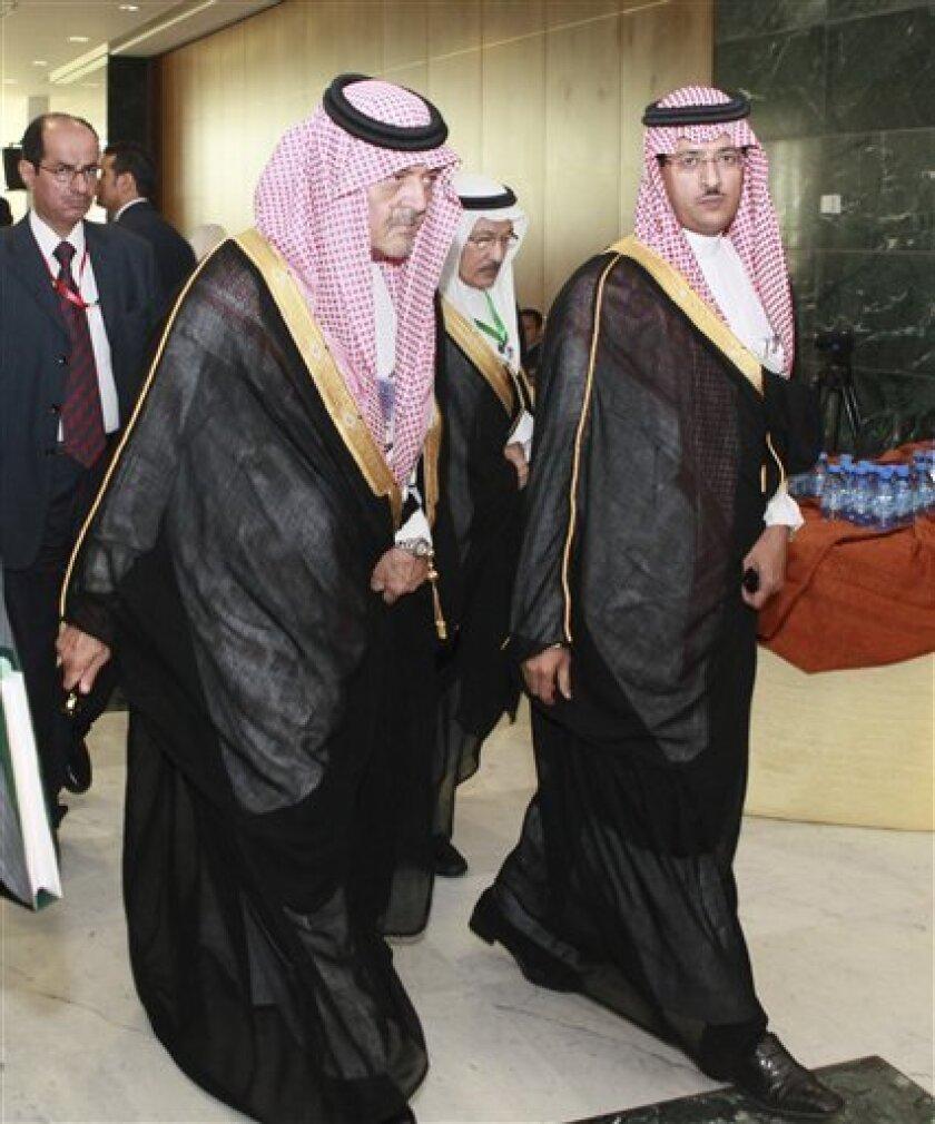 Saudi Arabian Foreign Minister Saud al-Faisal, left, leaves the Arab foreign ministers meeting in Sirte, Libya, Friday, Oct.8, 2010. Libya prepares to host one-day Arab League summit where Israeli-Palestinian talks expected to top agenda. (AP Photo/Abdel Magid Al Fergany)