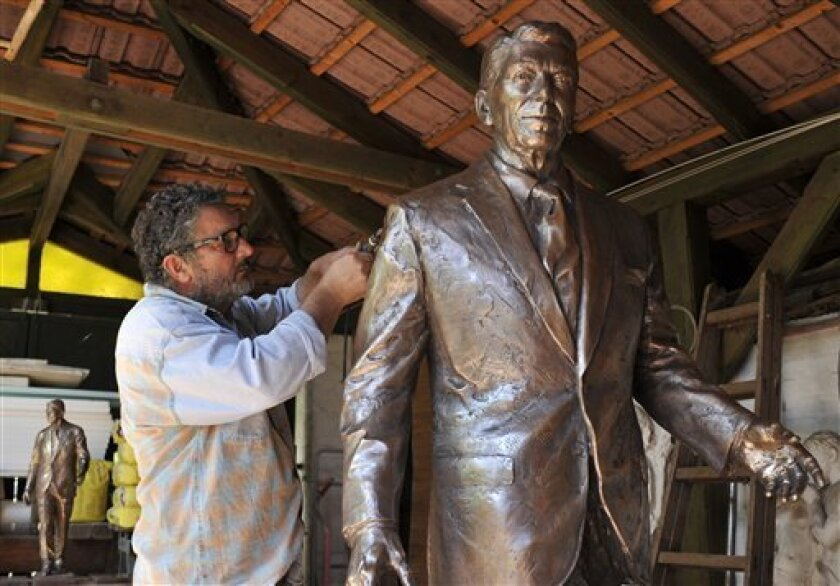 Hungarian sculptor Istvan Mate finishes up work on his statue of late US President Ronald Reagan in his workshop in the town of Csongrad, Hungary, Sunday, June 26, 2011.  Ronald Reagan never visited Hungary, but his efforts to end communism have endeared him to many Hungarians and this statue will