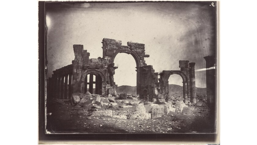 An ancient Roman triumphal arch at Palmyra, Syria, seen in an 1864 photograph by Louis Vignes and printed by Charles Gegre. ISIS forces recently destroyed the arch and other treasured ruins at Palmyra. The Getty Research Institute has acquired a set of 47 photographs by Vignes of Palmyra and Beirut.
