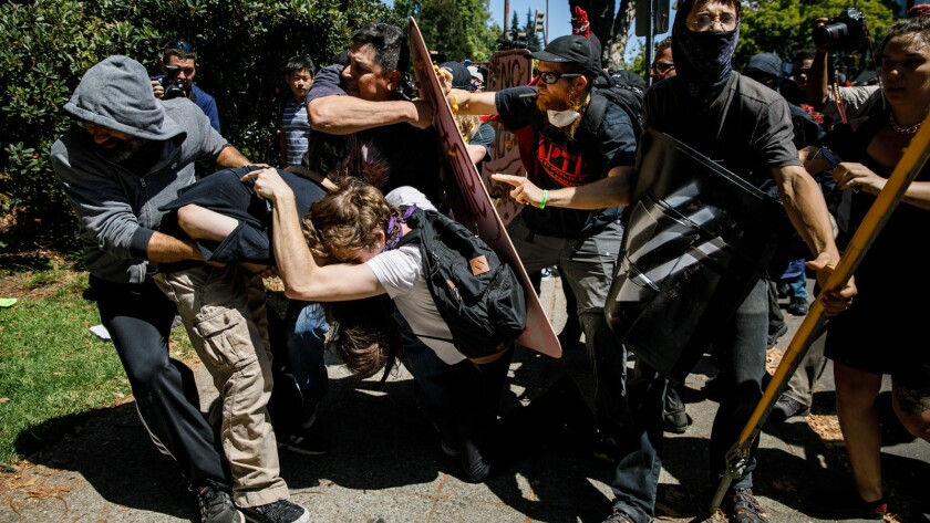Demonstrators clash Sunday at Civic Center Park in Berkeley.