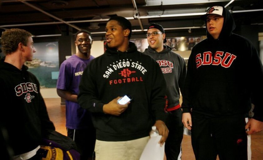 There seemed to be a small gathering of athletes going to SDSU, over on the sidelines Wednesday at the Hall of Champions. From left, are Seamus McMorrow, of St. Augusta High, headed to SDSU, in the background left is Cory Littleton of Mt. Miguel headed to the University of Washington, center foreground is Malcolm Jackson of Mt. Miguel, going to SDSU, in background right is Nico Siragusa of Mater Dei, and at right is Kwayde Miller of Ramona, both headed to SDSU.