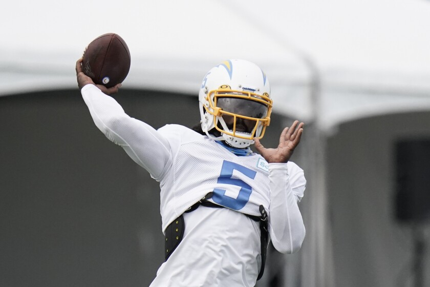 Chargers quarterback Tyrod Taylor throws a pass during training camp in Costa Mesa.