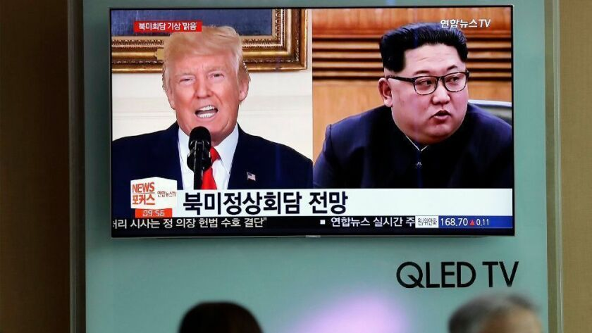 A TV at the Seoul Railway Station shows news on President Trump and North Korean leader Kim Jong Un.