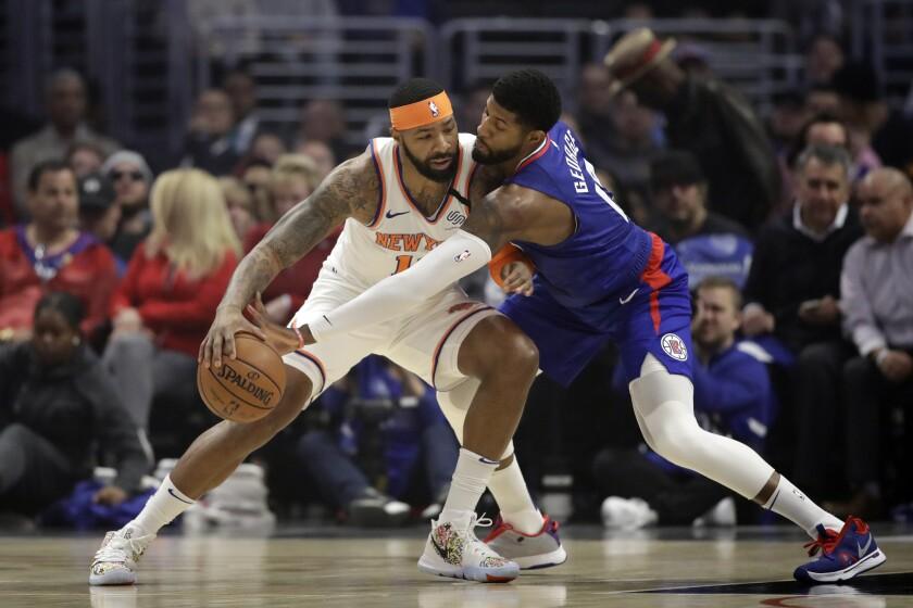 Paul George defends New York Knicks' Marcus Morris Sr.