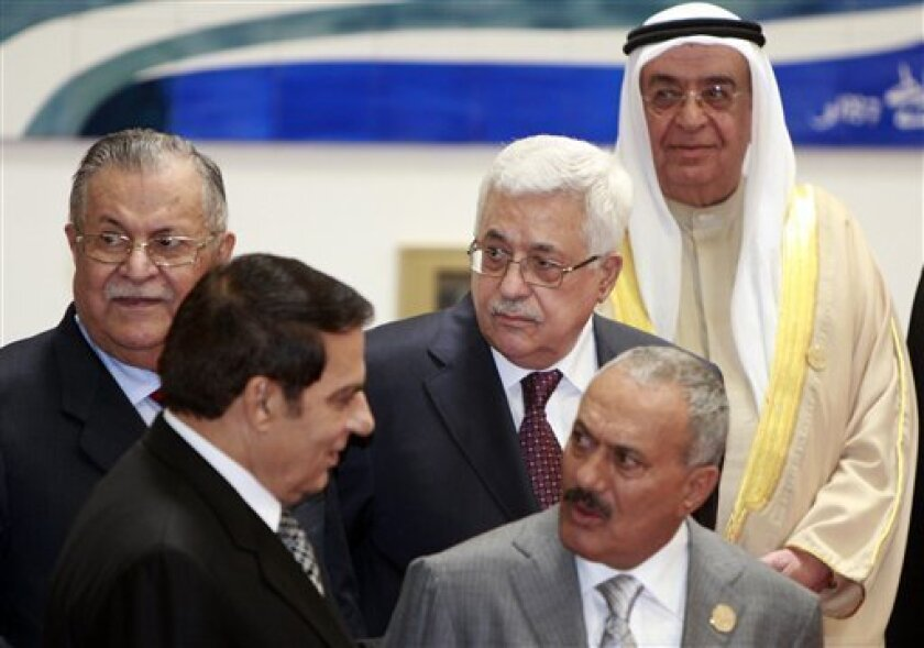 Palestinian President Mahmoud Abbas, center, looks on during a group pictured with Arab leader in Sirte, Libya, Saturday, Oct.9, 2010. Palestinian President Mahmoud Abbas and Arab League leaders gathered in Libya to discuss a deepening crisis over Israel's refusal to extend a slowdown in settlement construction in the Palestinian territories. Iraqi President Jalal Talabani, left, Tunisian President Zine Elabdine Bin Ali, second left,Yemeni President Ali Abdullah Saleh, second right, Bahrain''s Deputy Premier Sheikh Mohammed bin Mubarak, right. (AP Photo/Amr Nabil)