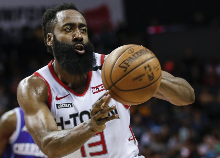 Rockets guard James Harden passes during a game against the Hornets on March 7, 2020, in Charlotte.