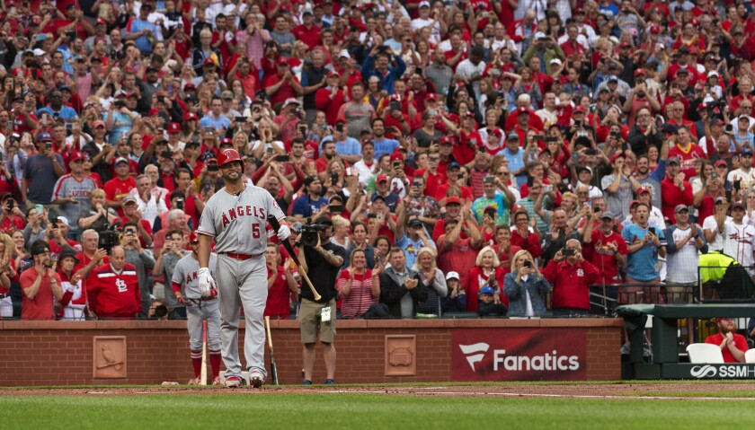 Angels' Albert Pujols is greeted by a standing ovation before his first at-bat during the first inning against the St. Louis Cardinals on Friday in St. Louis.
