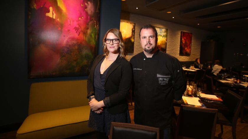 Co-owners Kate Perry and chef Mark McDonald, stand in the dining room of new Old Vine Cafe in Costa