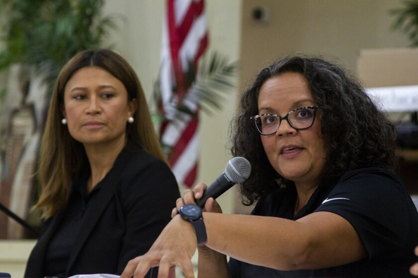 Co-principals Stephanie Brown and Melissa Agudelo speak at a community forum about Abraham Lincoln High