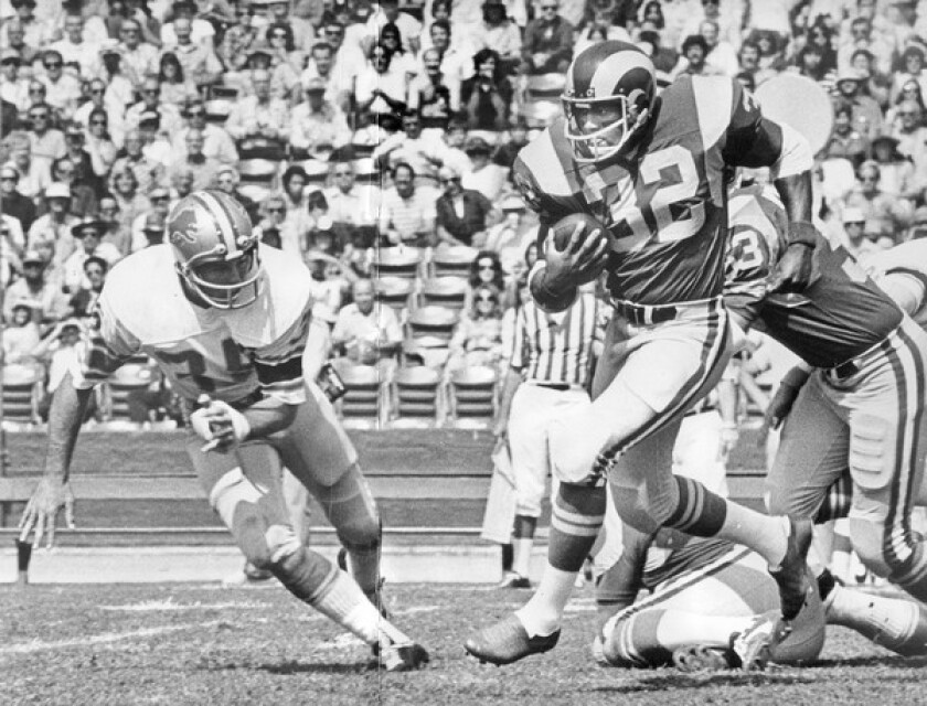 Cullen Bryant, seen in 1974 in his No. 32 jersey, breaks away toward the sidelines for a big gain on a kickoff return. In 13 seasons in the National Football League, he scored a total of 23 rushing and receiving touchdowns. He ran for 3,264 yards in 849 carries, and caught 148 passes for 1,176 yards.