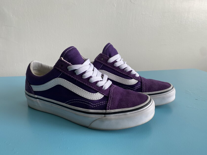 A pair of purple Vans Old Skool sneakers.