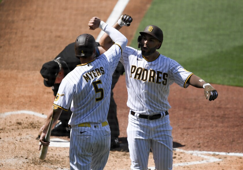 San Diego Padres' Eric Hosmer is congratulated by teammate Wil Myers after hitting a solo home run.