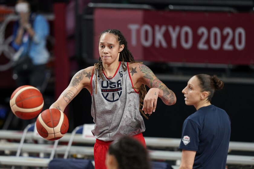 United States' Brittney Griner passes to a teammate during a women's basketball practice at the 2020 Summer Olympics, Saturday, July 24, 2021, in Saitama, Japan. (AP Photo/Charlie Neibergall)