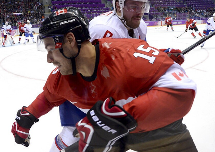Ducks captain Ryan Getzlaf, battling in the corner with Norway's Jonas Holoes during a gamer earlier in the Olympic hockey tournament, and Canada will play for the gold medal Sunday against Sweden.