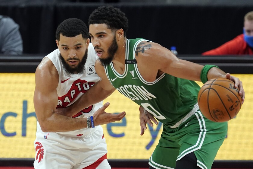 Boston Celtics forward Jayson Tatum (0) drives around Toronto Raptors guard Fred VanVleet (23) during the first half of an NBA basketball game Monday, Jan. 4, 2021, in Tampa, Fla. (AP Photo/Chris O'Meara)