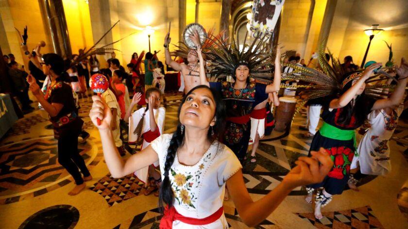 LOS ANGELES, CA - NOVEMBER 04, 2016 - Griselda Herrera, surrounded by dancers in the rotunda of Los