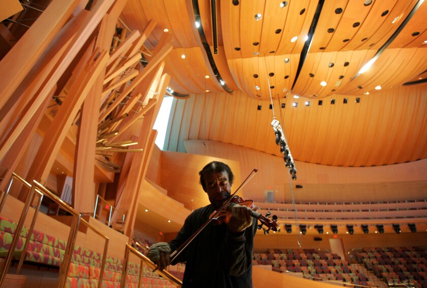 Nathaniel Anthony Ayers plays his violin in Walt Disney Concert Hall in Downtown Los Angeles.