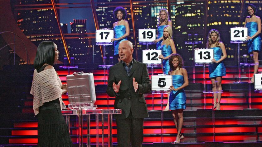 In this undated publicity photo released by NBC Universal, host Howie Mandel talks with a contestant