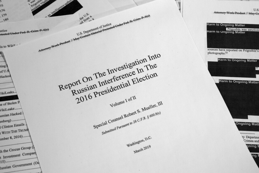 FILE - This Thursday, April 18, 2019 file photo shows special counsel Robert Mueller's redacted report on Russian interference in the 2016 presidential election as released in Washington. An Associated Press review shows the idea of Ukrainian interference took root during Donald Trump's 2016 presidential campaign, was spread online and then amplified by Putin before some of America's elected officials made it their truth. (AP Photo/Jon Elswick)
