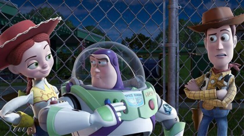 """In this film publicity image released by Disney, from left, Jessie, voiced by Joan Cusack, Buzz Lightyear, voiced by Tim Allen and Woody, voiced by Tom Hanks are shown in a scene from """"Toy Story 3."""" (AP Photo/Disney Pixar) NO SALES"""