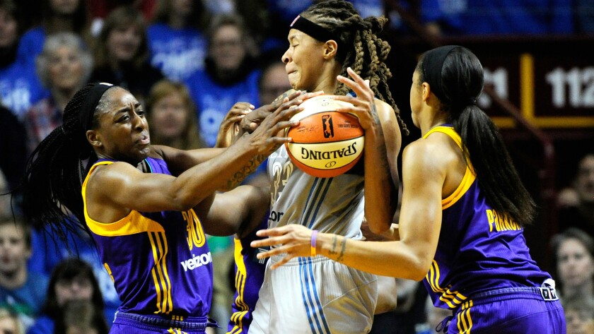 Sparks forwards Nneka Ogwumike (30) and Candace Park (3) double-team Lynx forward Maya Moore during Game 2 of the WNBA Finals.