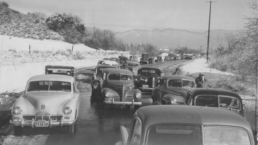 Cars sit on Sepulveda Blvd. in Sherman Oaks in 1949 while their owners wait for ice on the roads to melt so that they can drive over the Sepulveda Pass into Beverly Hills.