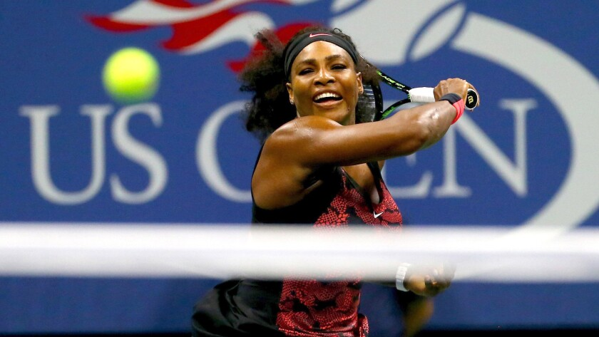 Serena Williams returns a shot against Bethanie Mattek-Sands during their third-round match at the U.S. Open on Friday in New York.