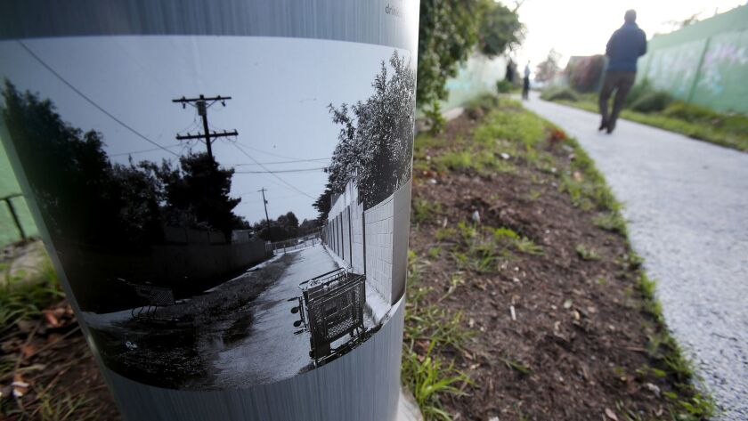 LOS ANGELES, CALIF. - JAN. 24, 2017. A sign post shows a picture of previous draininage problems at